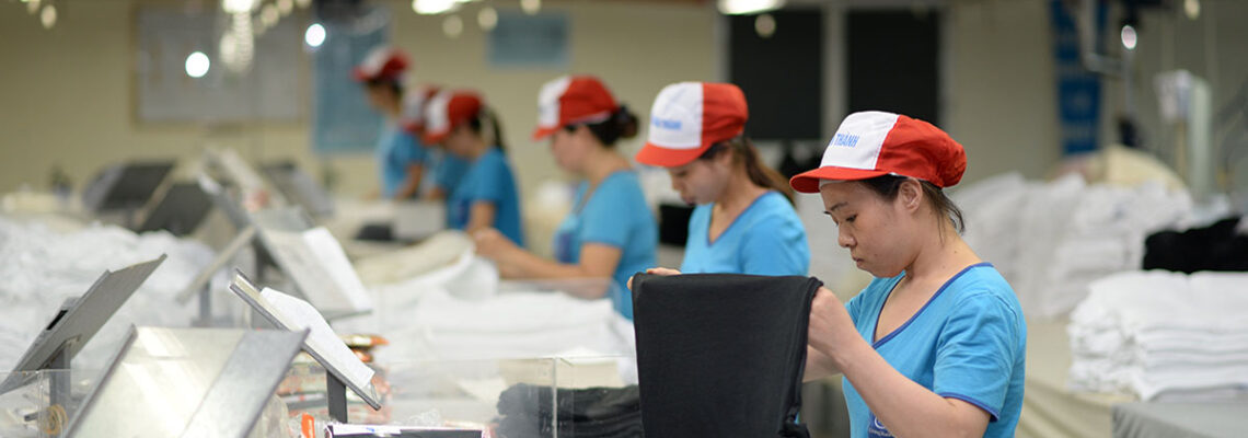 Employees are at work at an apparel facility. Vietnam posted US$1.64 billion in trade surplus between January and February